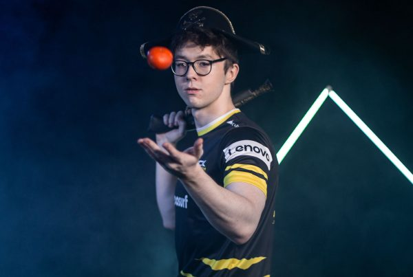 Photo of K1CK player throwing a ball and holding numb chucks